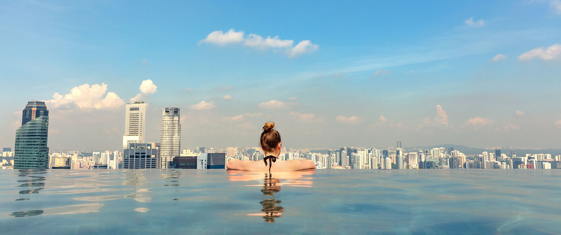 Female Tourist In Infinity Pool Of Marina Bay Singapore